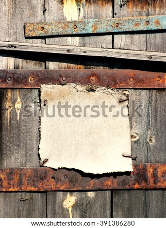 Abstract rusty grunge frame nailed down on wooden background - stock photo