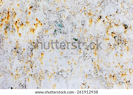 Abstract rusty metal surface with cracked white paint. Textured background for your concept or project. Great background or texture. - stock photo