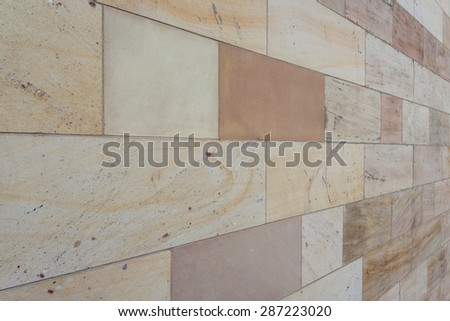 abstract sandstone wall background - stock photo