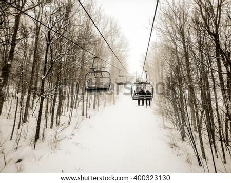 abstract scenes at ski resort during snow storm - stock photo