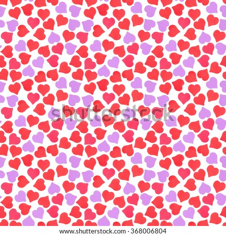 Abstract seamless pattern of shining red, pink and purple confetti heart-shape isolated on white