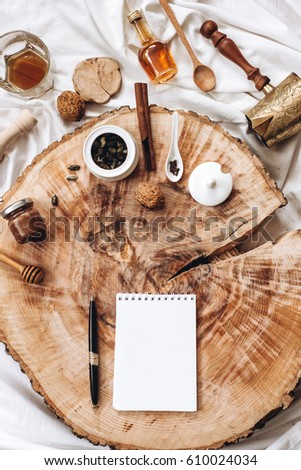 abstract set of kitchen utensils, cooking appliances and spices with notepad and pen on wooden background, idea concept cooking food with copy space. top view