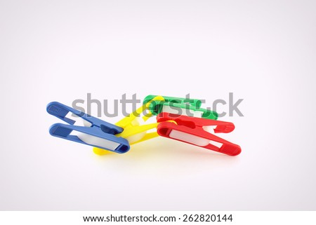 Abstract shape from four color clothes-pegs - stock photo