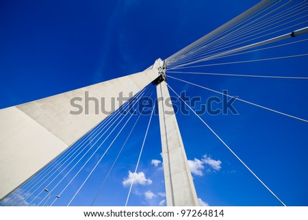 Abstract shape of a contemporary Swietokrzyski suspension bridge in Warsaw, Poland. - stock photo