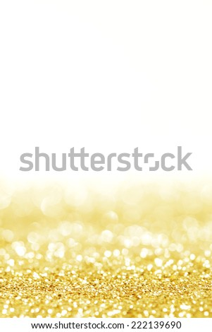 Abstract shining glitters gold holiday bokeh background with white copy space - stock photo