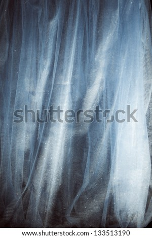 abstract shiny tulle fabric studio shot - stock photo