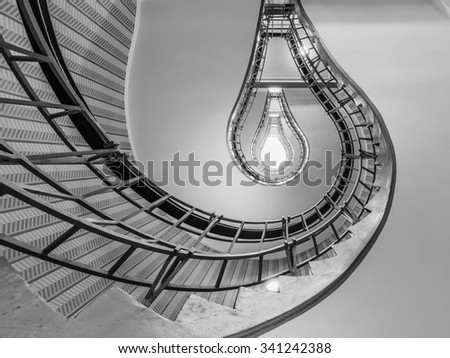 Abstract shot of a staircase leading towards a light bulb like opening - stock photo