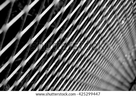Abstract shot of metal fencing showing vanishing point and perspective