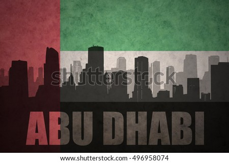abstract silhouette of the city with text Abu Dhabi at the vintage united arab emirates flag background