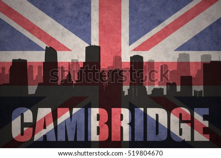 abstract silhouette of the city with text Cambridge at the vintage british flag background
