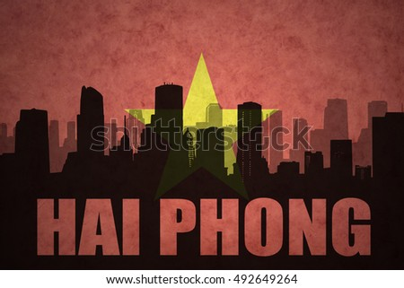 abstract silhouette of the city with text Hai Phong at the vintage vietnamese flag background