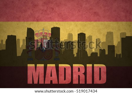 abstract silhouette of the city with text Madrid at the vintage spanish flag
