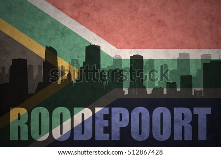abstract silhouette of the city with text Roodepoort at the vintage south africa flag background