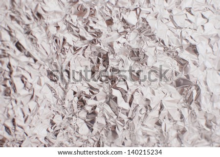 abstract silver rough wrinkle foil texture background - stock photo