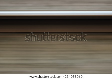 Abstract single rail in motion blur fast railway  - stock photo