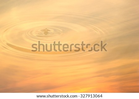 Abstract sky orange sunset of water reflection and water drop for background.  - stock photo