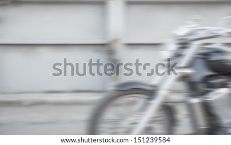 Abstract slow motion, biker riding motorbike, driver racing on the big red bike, side view, blur movement, summer road trip, speed concept - stock photo