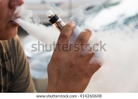 Abstract Smoke from Electric cigarette - stock photo