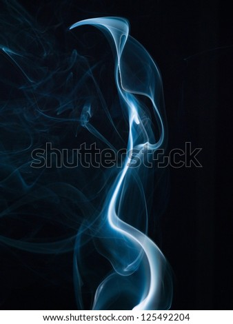 Abstract smoke isolated on black. Background - stock photo
