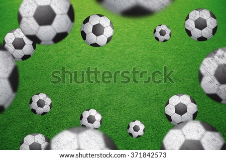 Abstract soccer field with many soccer balls. Blurred and grunge textured soccer balls on green football field background with copy space. Selective focus used. Conceptual soccer balls background.