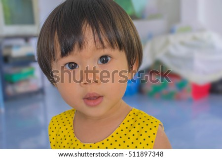 Abstract soft blurred and soft focus the cute Thai girl,the cute baby in the room with natural light.