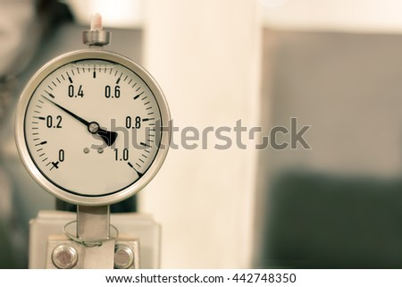 abstract soft focus pressure gauge with pipeline construction at offshore platform industrial equipment background concept.