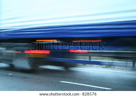 Abstract speed blur of lorry focus on road - stock photo