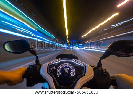 Abstract speed motion background, night city motorbike ride, selective focus on speedometer.