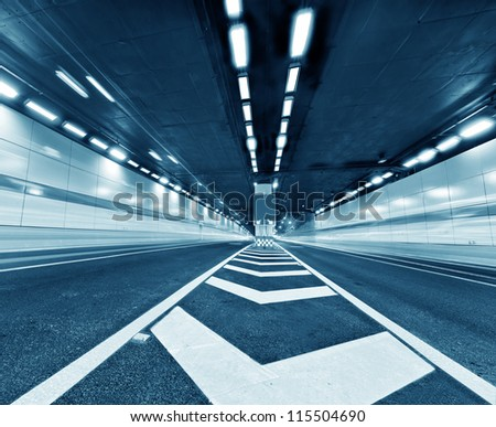Abstract speed motion in urban highway road tunnel, blurred motion toward the central. Shot from a slow moving car - stock photo