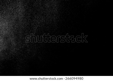 abstract splashes of milk on a black background