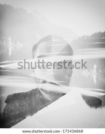 abstract spooky double exposure man in the black lake  - stock photo