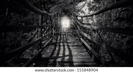 abstract spooky  wooden bridge with man silhouette in black and white