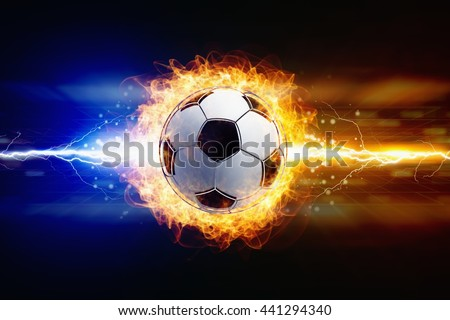 Abstract sports background - bright powerful lightnings strike burning soccer ball - stock photo