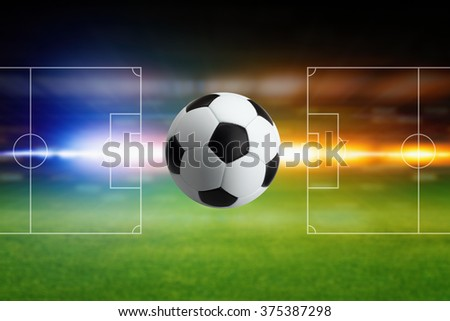 Abstract sports background - soccer ball, green field with layout, bright blue and orange light - stock photo