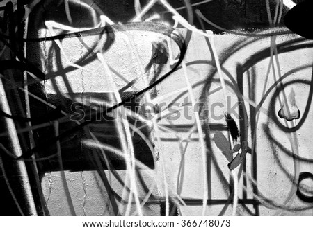 Abstract spray painting graffiti wall background. Random stroke line with spray. Rustic and grunge texture urban. Agitate, disturb and annoy. Black and white colors. Close up.