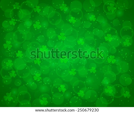 Abstract St Patrick's day background decorated with shamrocks and bokeh lights. Vector available.
