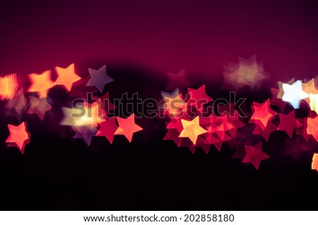 Abstract star shape bokeh background of town - stock photo