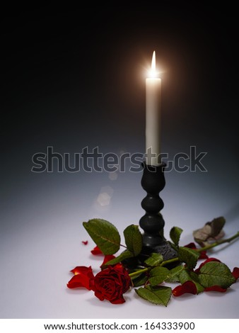 Abstract still life with burning candle for your design - stock photo