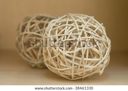 Abstract straw balls on the wood shelf - stock photo