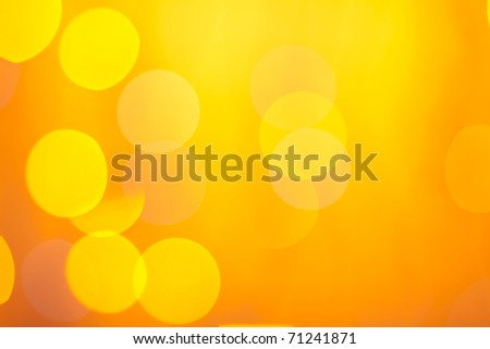 Abstract sunny bokeh on orange background - stock photo