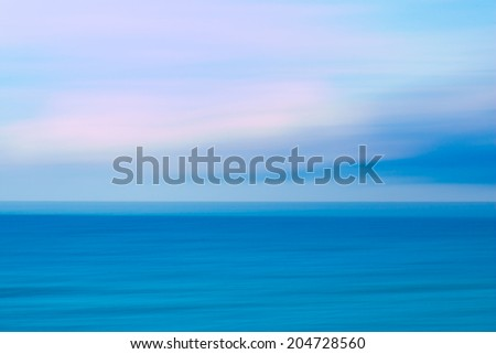 Abstract sunset sky and  ocean, nature background with blurred panning motion. - stock photo