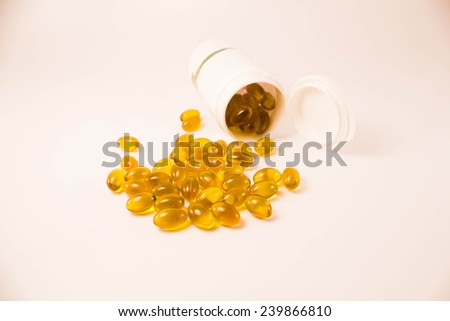 abstract Supplementary food - Omega3 capsules spilled from the bottle - stock photo