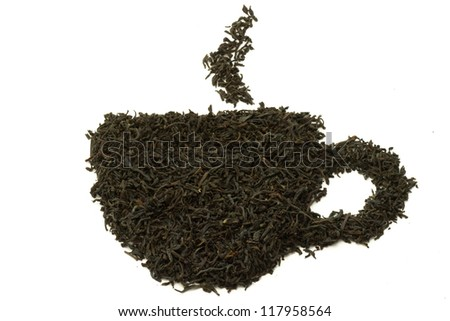 Abstract tea cup made of tea leaves - stock photo
