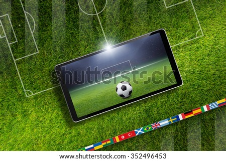 Abstract technological background - soccer ball and stadium on screen of smartphone, sports game online, field layout