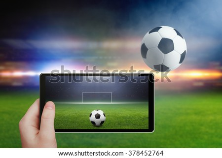 Abstract technology background - tablet pc in hand, soccer ball, soccer stadium in night, sports game online, soccer online, augmented reality concept - stock photo