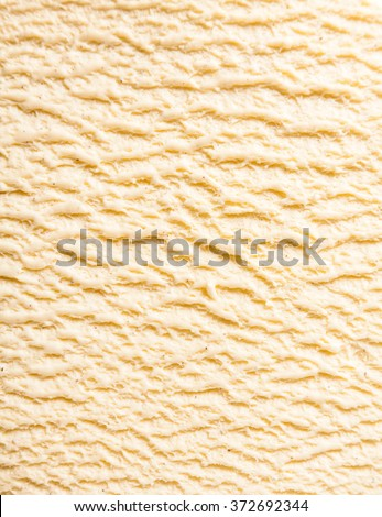 Abstract Texture Background - Close Up of Ridges in Surface of Creamy, Sweet and Cold Vanilla Bourbon Frozen Dairy Ice Cream Dessert - stock photo
