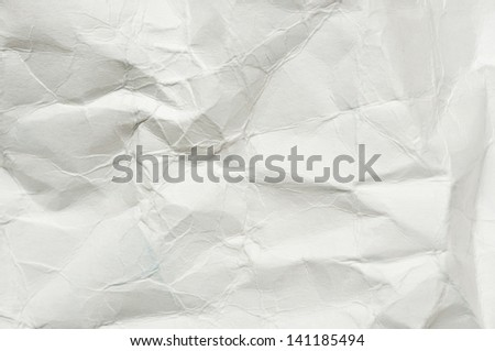 Abstract texture from sheet of white crumpled paper - stock photo