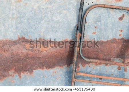 Abstract texture of rusted rough steel sheet background. Brown and orange rusted stains pattern on gray corroded grunge metal surface texture sheet with old rusted steel metal chair frame background