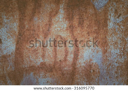 Abstract texture of rusty metal. Grunge background for design. Color toning. Low contrast - stock photo