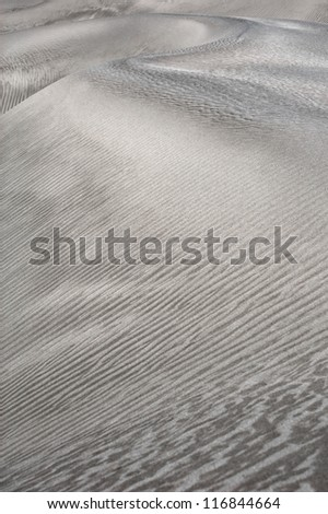 Abstract texture of sand dune in desert - stock photo